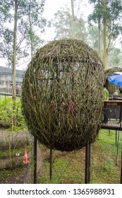 """Lembang, Bandung, Indonesia - CIRCA July 2014: These interesting """"cocoon"""" from tree branches are actually restaurants; located in Dusun Bambu, Lembang, Bandung, West Java, Indonesia."""