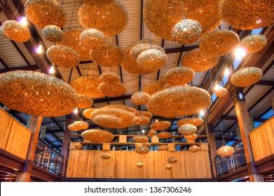"""Lembang, Bandung, Indonesia - CIRCA July 2014: Those floating """"bubbles"""" are actually lamp shades, made from bamboo wicker (woven bamboo), in Dusun Bambu, Lembang, Bandung, West Java, Indonesia."""
