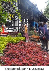 Lembang, Bandung, Jawa Barat, Indonesia - December 11, 2016 : Tourist visitors are taking pictures in the area of the tourist building which has many leaves