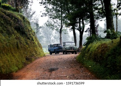Lembang, Bandung, West Java, Indonesia. Old classic 4x4 Landrover Series Offroading Jungle Forest at West Java, Indonesia