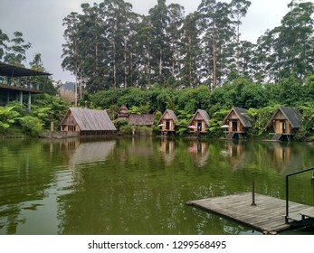 Lembang, West Java, Indonesia - September 1 2018: Lake view from Purbasari Restaurant at Dusun Bambu Family Leisure Park with Pine trees at the background