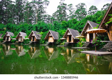 Lembang.Bandung/Indonesia - August 11th 2018: A lake surrounded by wooden houses and terraces in Bamboo Village (Dusun Bambu)