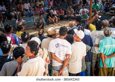 LEMBONGAN, BALI, INDONESIA - MAY 10, 2010: A large crowd at a cockfighting event in Jungutbatu village. Cockfights are very popular events among Balinese men.