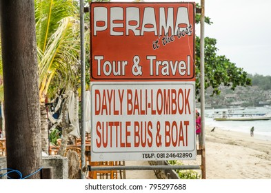LEMBONGAN, INDONESIA - MARCH 21: a sign advertising tours and travel on March 21, 2017 in Lembongan, Indonesia. Lembongan Island is a popular tourist destination and a short boat ride from Bali.