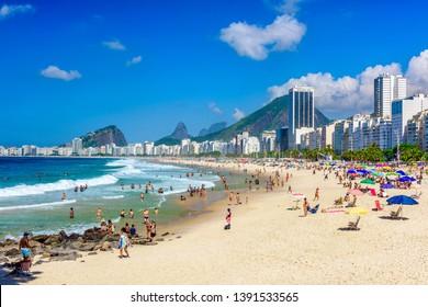 Leme and Copacabana beach in Rio de Janeiro, Brazil. Copacabana beach is the most famous beach in Rio de Janeiro. Sunny cityscape of Rio de Janeiro