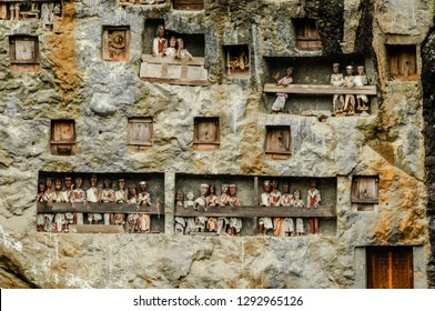 LEMO, RANTEPAO, SULAWESI - OCT 21, 2009: typical Toraja tombs carved into the rock face with traditional puppets, tau tau, in memory of dead people, Lomo Village 21 October 2009.