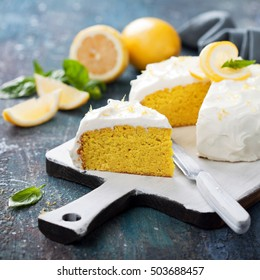 Lemon almond gluten free cake with cream cheese frosting, selective focus