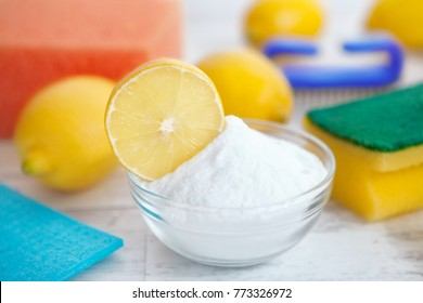 Lemon and baking soda in a bowl, natural eco cleaners