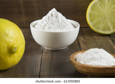 Lemon and baking soda on wooden table