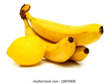 lemon and banana on white. Isolation.