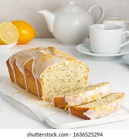 Lemon bread coated with sugar sweet icing and sprinkled with lemon peel. Slice of cake with citrus, poppy, traditional american cuisine, loaf.