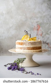 Lemon cake on cake stand,Light dessert with lemon.Naked cake with mascarpone, lemon and whipped cream
