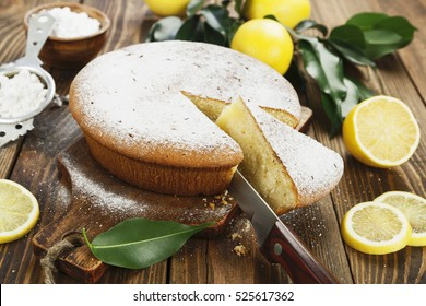 Lemon cake with sugar powder on the wooden table