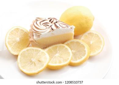 Lemon cheese tart on white background - Soft Focus