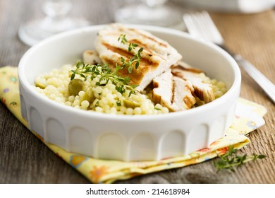 Lemon chicken with thyme and couscous