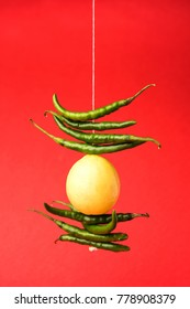 Lemon Chilies tied with thread and tied for hanging on doors at home OR shop to avoid any bad fortune also known as totka or nazar battu