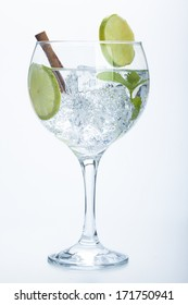 lemon and cinnamon gin tonic isolated over white background