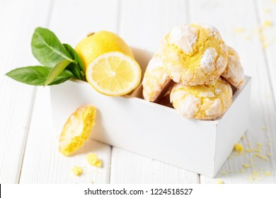 Lemon cookies on white wooden box, on white background