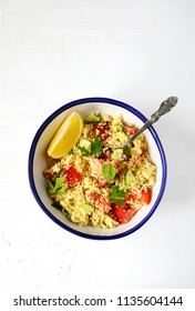 Lemon couscous. Couscous with tomato, cucamber, lemon and herbs. Traditional Arabic Salad Tabbouleh. Top view