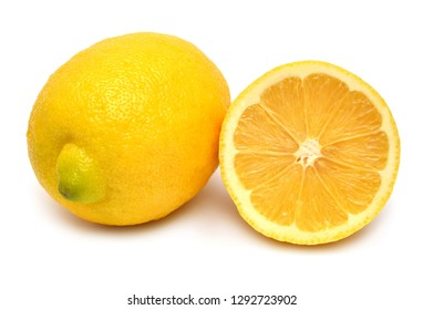 Lemon creative whole and half isolated on white background. Yellow fruit. Flat lay, top view