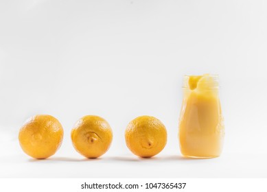 lemon curd in a glass jar on a white background, ingredients for cooking, lemon kyrd recipe