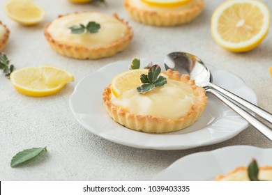 lemon curd tarts on white table