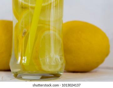 lemon detox water with lemon on the table