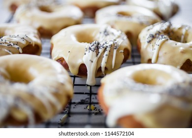 Lemon donuts with white chocolate and poppy seeds