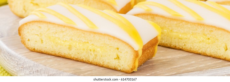 Lemon Drizzle Cake - Slices of lemon cake topped with icing.