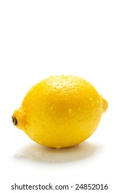 Lemon with drop isolated on a white background.
