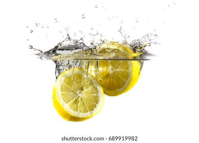 Lemon dropped in water. Splash everywhere