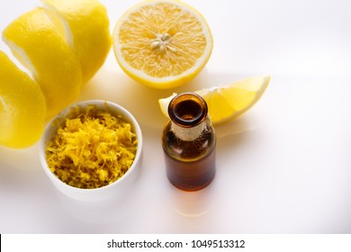Lemon essential oil on a white background