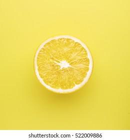 Lemon fruit. Juicy slice of lemon on a yellow background isolated