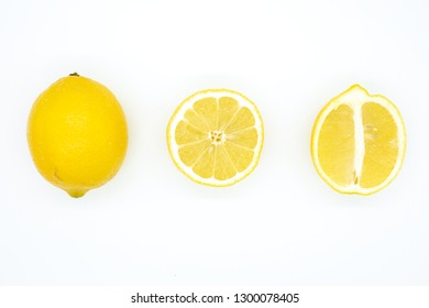 Lemon fruit on white backdrop in simple pattern