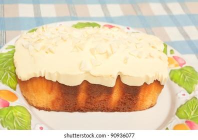 Lemon fudge cake on a plate, on table
