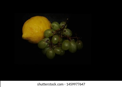 lemon and grapes in high definition, black background Caravaggio style
