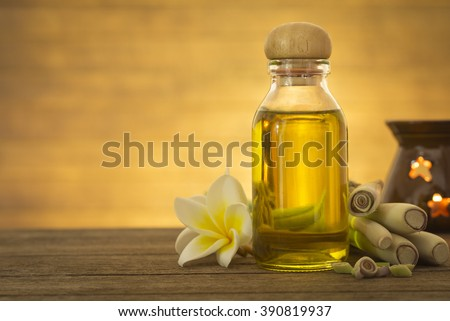 Lemon grass essential oils placed on a wooden table. Space for your text. Spa concept.