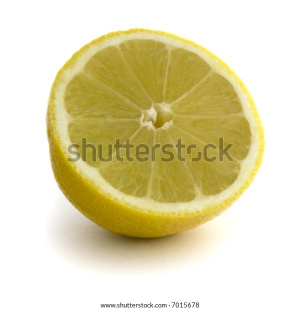 Lemon Half: Straight Product Shot taken in Studio in Natural Light isolated against White Background