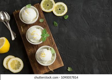 Lemon Ice Cream in bowl. Homemade citrus lemon ice cream (gelato) with mint close up.