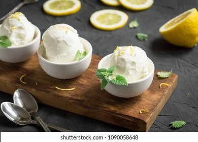 Lemon Ice Cream in bowl. Homemade citrus lemon ice cream (gelato) with mint close up.