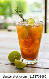 lemon iced tea on wooden table with dressing fruits