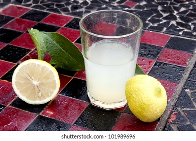 Lemon juice and lemon on a chess board