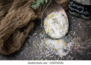 Lemon Lavender Herb Salt in Tarnished Spoon on Black Background with Fresh Sprig of Lavender