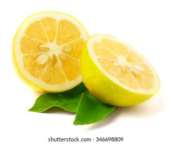 Lemon with leaf isolated on white.