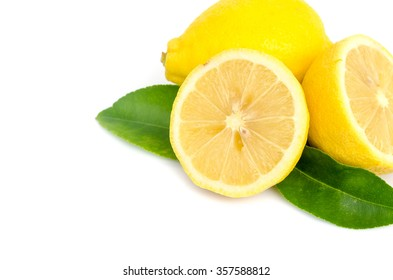 Lemon with leaves on white.