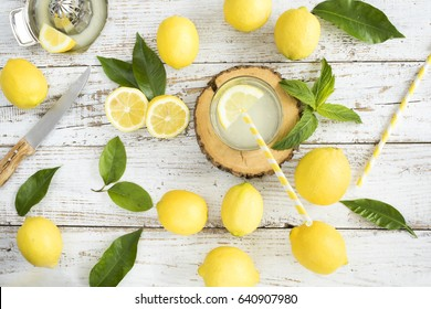 Lemon with lemonade on wooden background