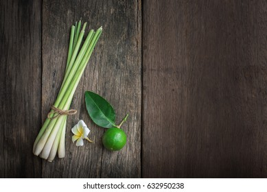 Lemon and lemongrass are placed on old wooden floor.
