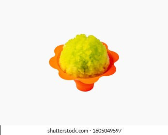 Lemon lime green Hawaiian Shave ice, shaved ice or snow cone in an orange colored flower shaped serving container.