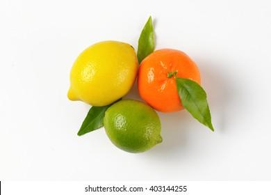 lemon, lime and tangerine on white background