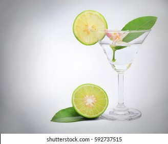 Lemon with martini glass on the white background, lemonade